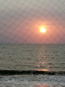 Sunset through the balcony nets and clouds